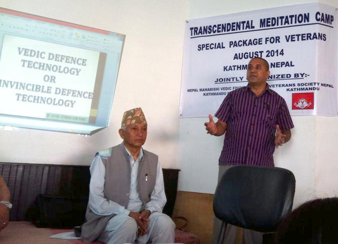 Author Col. (Retd) Jitendra Karki lectures about Invincible Defense Technology  while former Nepalese Home Minister, Deepak Prakash Baskota attentively listens