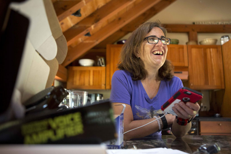 Jessie Levine smiles as she listens to her recorded outgoing phone message on her iPhone in Springfield, New Hampshire on Friday, June 24, 2016. Photo: AP