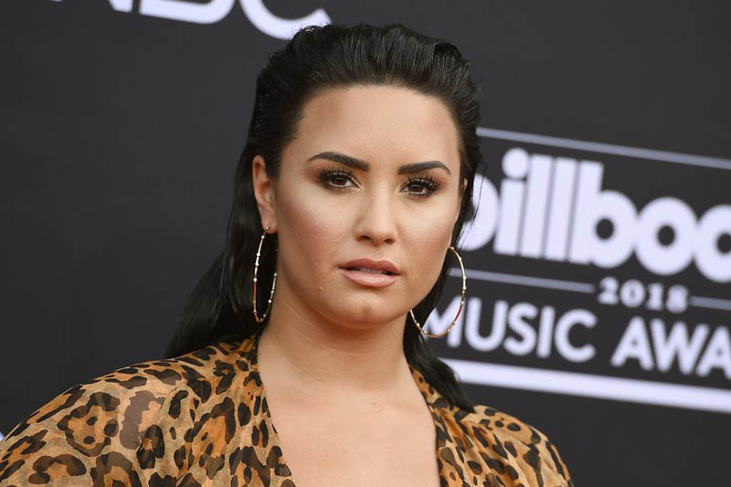 Singer Demi Lovato awake after suspected overdose: media reports