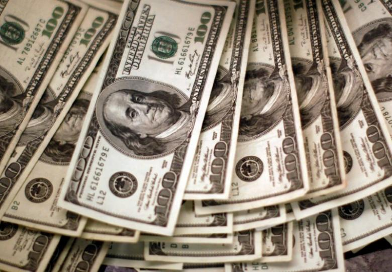 Dollar stands tall, hoisted by higher U.S. yields on Trump bets