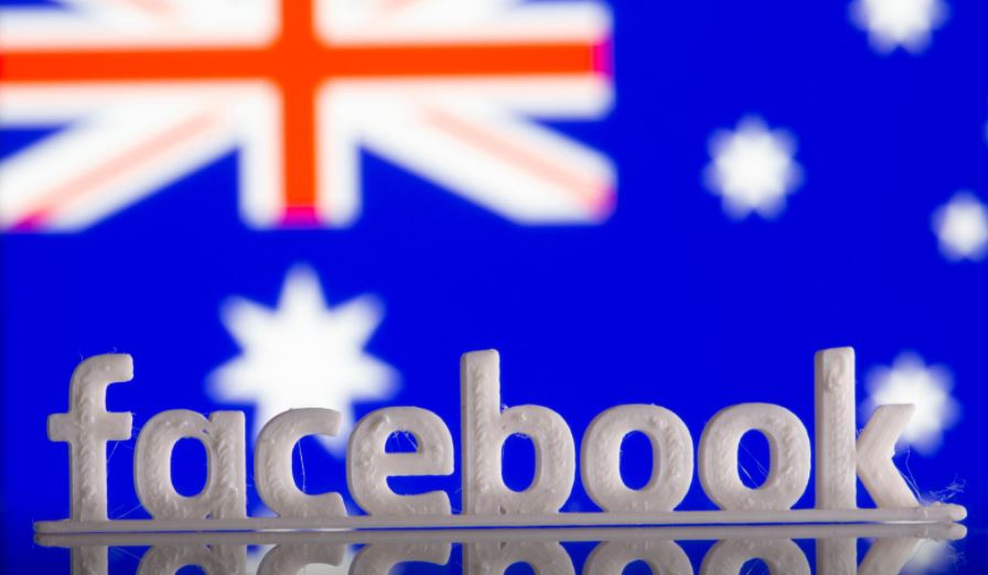 Facebook switches news back on in Australia, signs content deals
