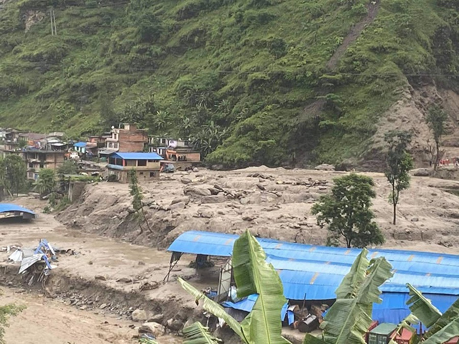 Floods followed by torrential rainfall swept away at least 25 people in Sindhupalchok district, two bodies recovered