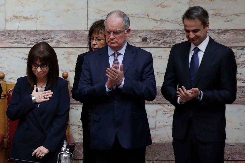 Greece swears in first female president, no handshakes amid coronavirus