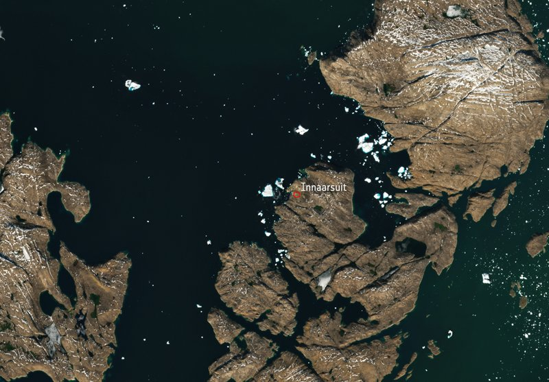 Iceberg looming over Greenland village is spotted from space