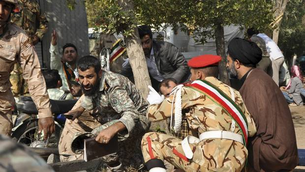 Gunmen kill at least 25 in attack on annual military parade in Iran