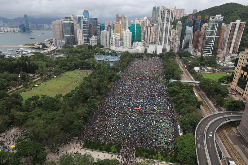 Tens of thousands flood Hong Kong park for new rally