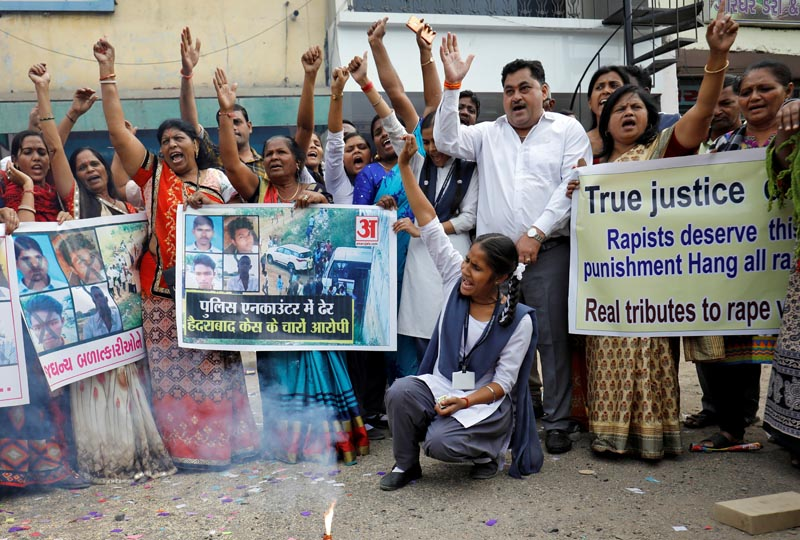 Indian police kill 4 men suspected of gang rape, murder; draw cheers