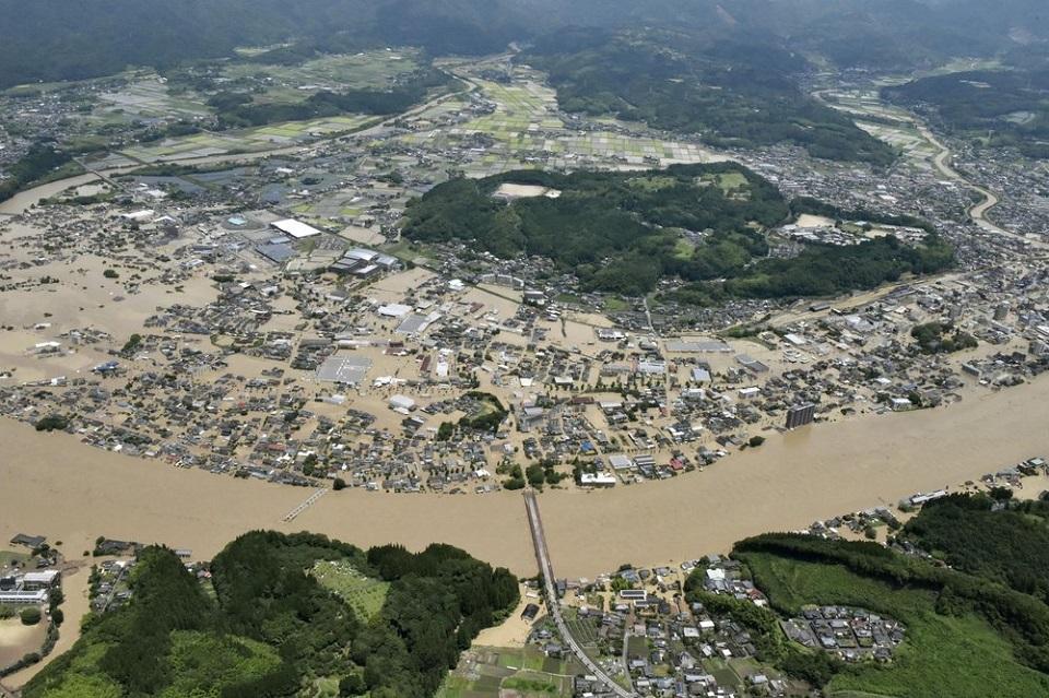 Heavy rain floods southern Japan; over a dozen presumed dead