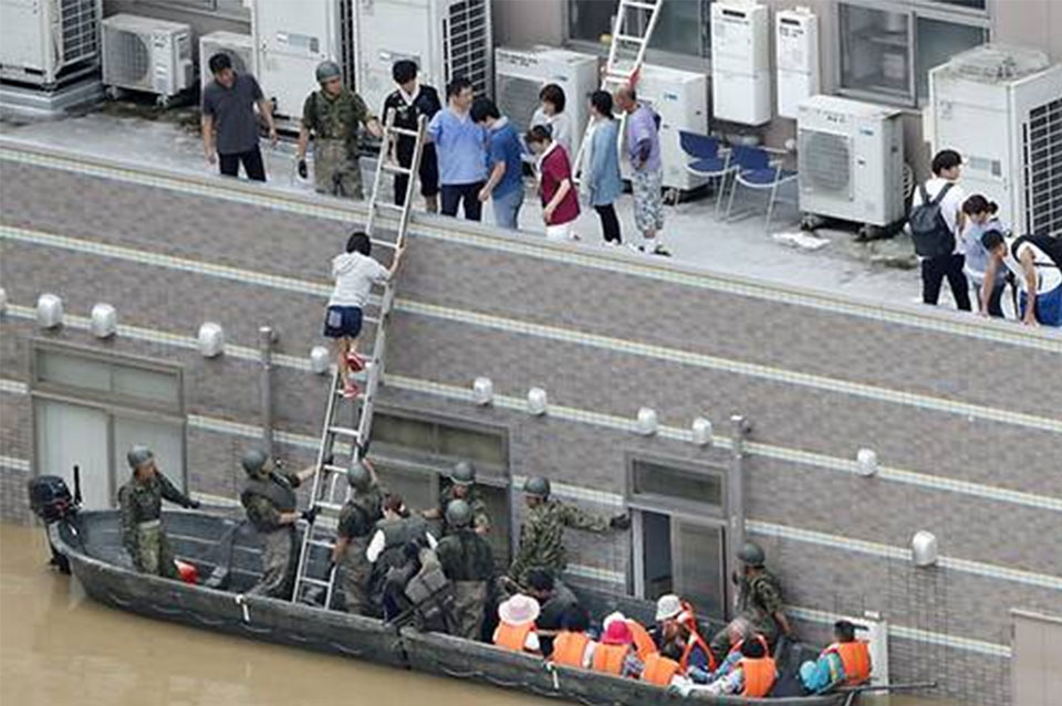 Japanese government says 100 are dead or presumed dead after heavy rains, floods and mudslides in western Japan