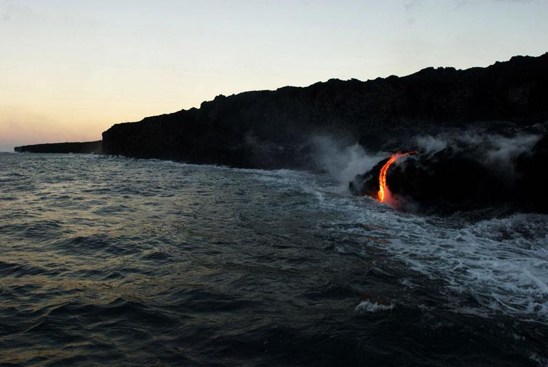 Lava from Hawaii volcano cascades into sea in vivid display