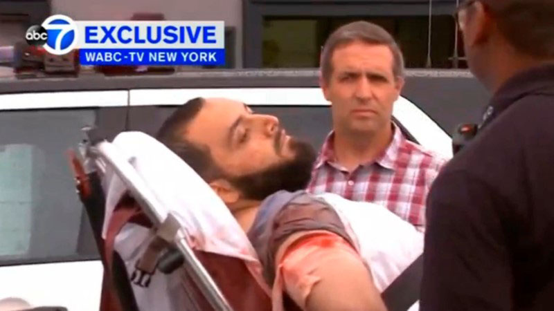 A still image captured from a video from WABC television shows a conscious man believed to be New York bombing suspect Ahmad Khan Rahami being loaded into an ambulance after a shoot-out with police in Linden, New Jersey, US, on September 19, 2016. Photo: WABC-TV via Reuters