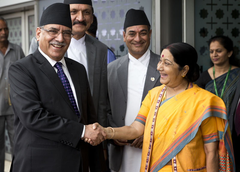 Indian Minister for External Affairs Sushma Swaraj (right) receives Nepali Prime Minister Pushpa Kamal Dahal as he arrives in New Delhi, India, on Thursday, September 15, 2016. Dahal is on a four-day visit to India. Photo: AP