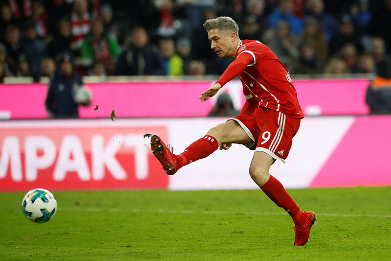 Atomic blond Lewandowski double stretches Bayern winning run