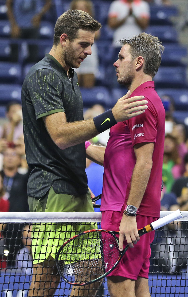 Stan Wawrinka (right) of Switzerland (right) and Juan Martin del Potro, of Argentina, meet at the net after Wawrinka's 7-6 (5), 4-6, 6-3, 6-2 win in the quarterfinals of the US Open tennis tournament, on Thursday, September 8, 2016, in New York. Photo: AP