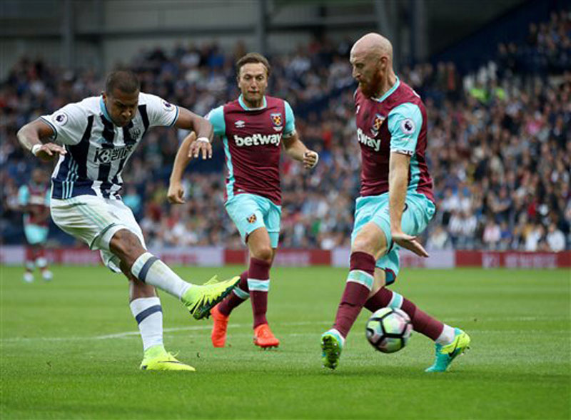 West Bromwich Albion s Jose Salomon Rondon, left, scores his side s second goal of the game, during the English Premier League soccer match between West Bromwich Albion and West Ham, at The Hawthorns, in West Bromwich, England.